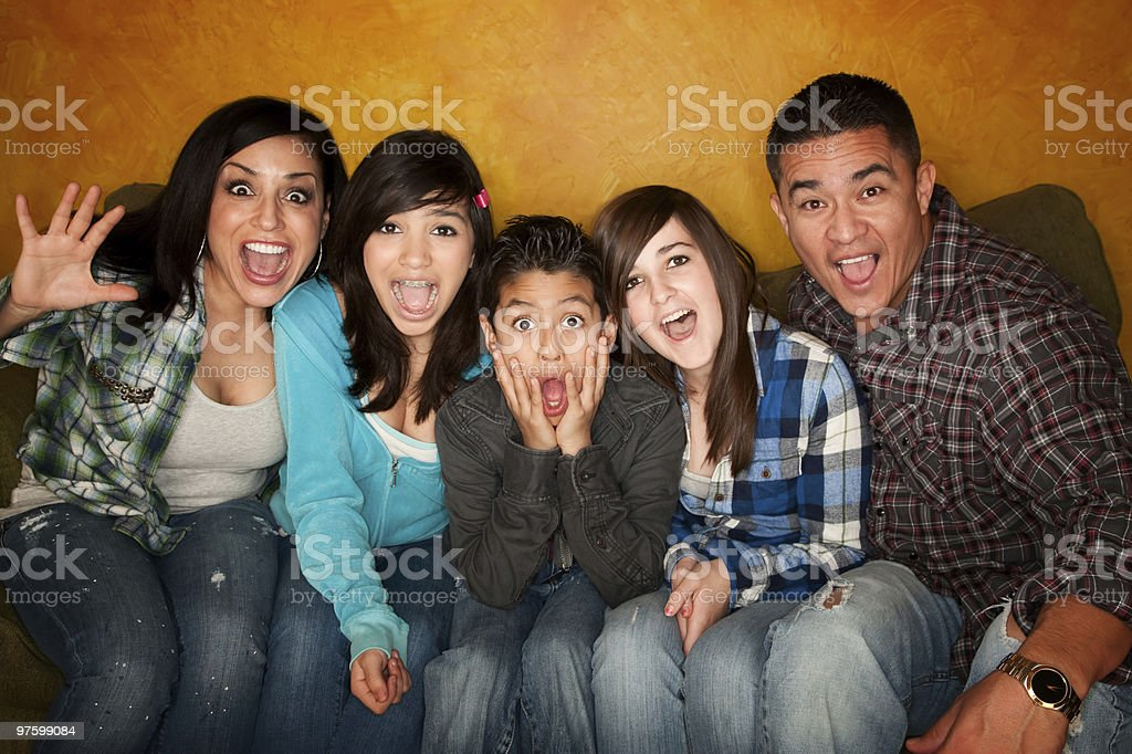 Hispanic Family with Big Reaction royaltyfri bildbanksbilder