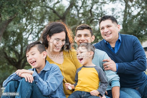 istock Hispanic family with three boys laughing 680789944