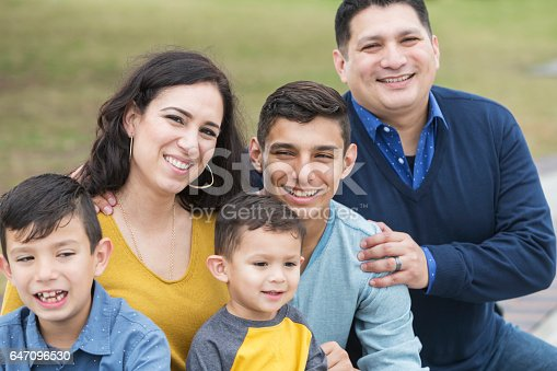 istock Hispanic family with three boys 647096530
