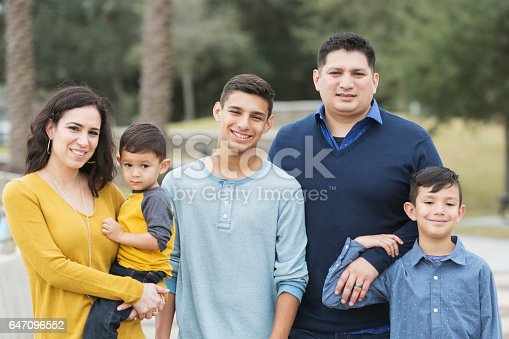 istock Hispanic family with three boys 647096552