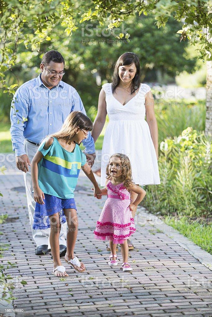 Hispanic family with two girls royalty-free stock photo