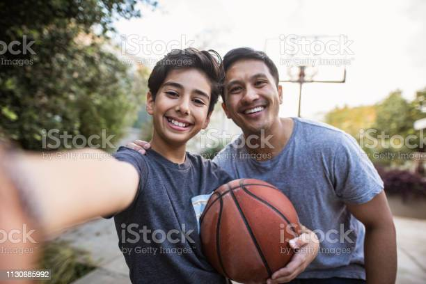 Hispanic father and son taking a selfie outdoors whilst playing picture id1130685992?b=1&k=6&m=1130685992&s=612x612&h=etw944u ghbooxtkgj8dv hrpo frtlnri4f3dgdbpy=