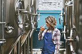 istock Hispanic Female Craft Brewer Examining Beer Sample 1197894094