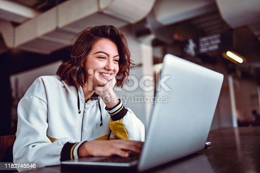 Hispanic Female Studying On Laptop