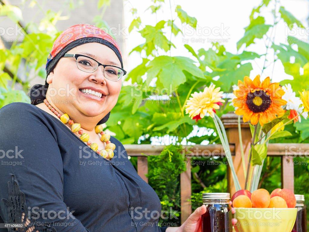 Hispanic Female With Bright Smile Dining Outdoors stock photo