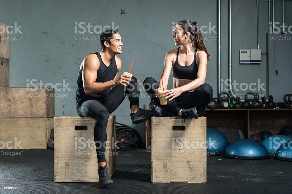 Hispanic Fitness Couple Drinking A Smoothie stock photo