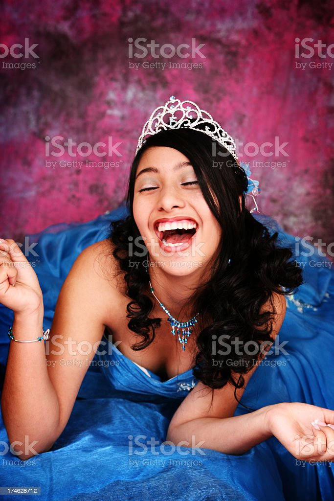 A Hispanic girl in a blue ball gown stock photo