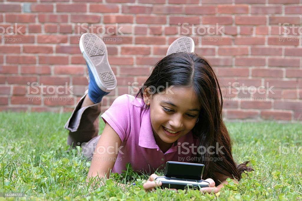 Hispanic Girl Text Messaging royalty-free stock photo