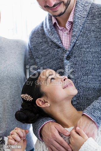 135384905 istock photo Hispanic girl with loving family 1187262745