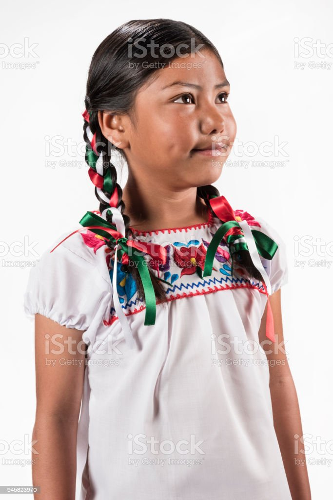 Hispanic girl with native embroidered blouse stock photo
