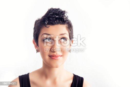 Hispanic Girl With Short Hair Looks Up Stock Photo & More