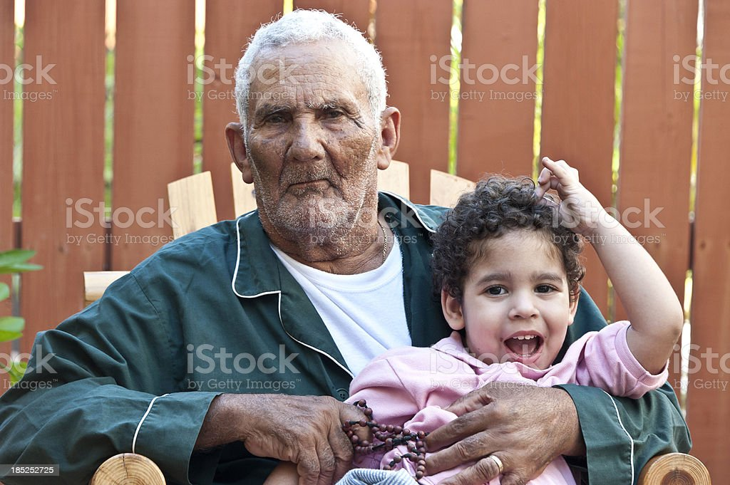 Hispanic grandfather with his grandson stock photo