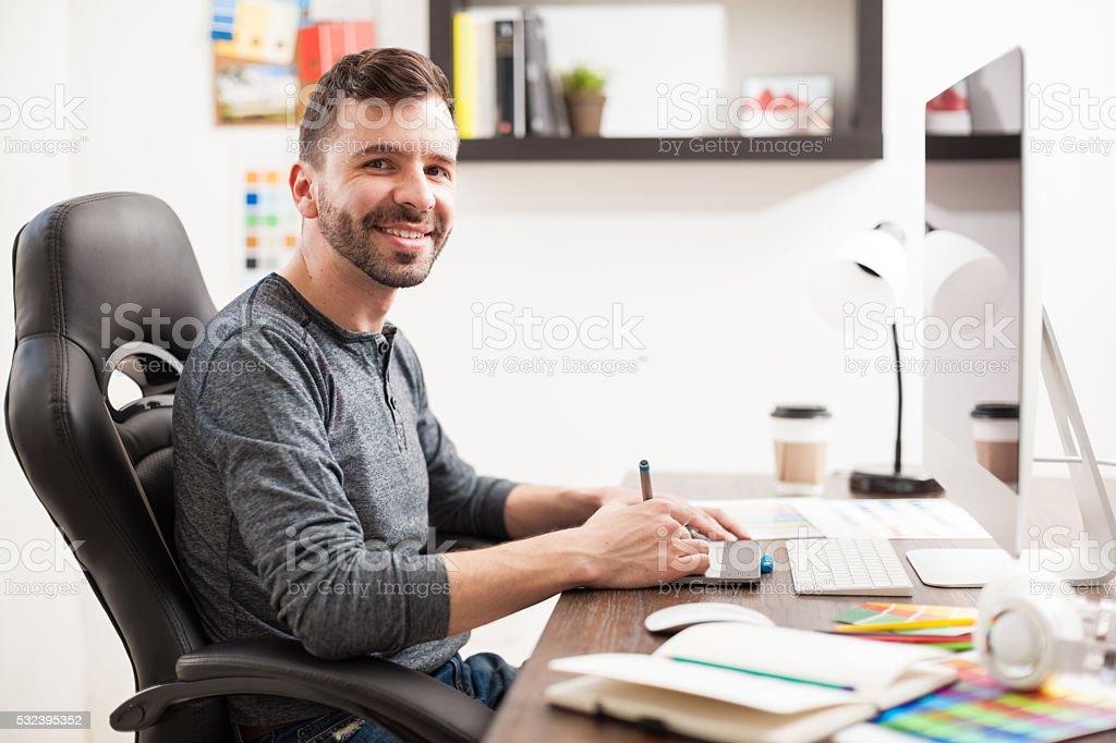 Hispanic graphic designer at work stock photo