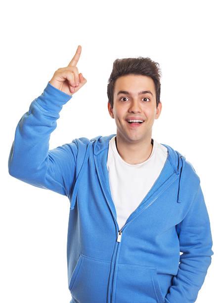 Hispanic guy pointing upwards stock photo