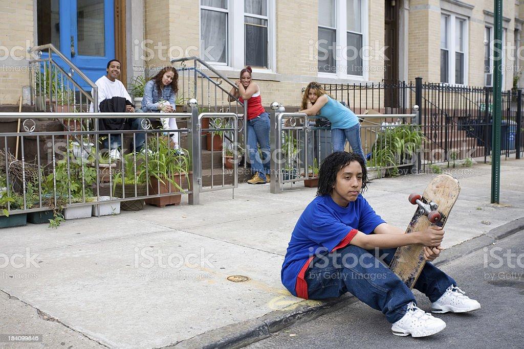 Hispanic kids killing time stock photo