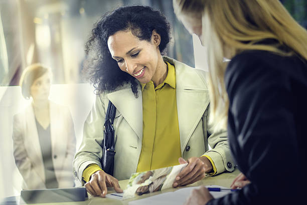 Hispanic lady at an insurance agency counter stock photo