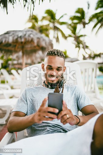 Hispanic Male Is Making A Video Call From Cuban Tourist Resort