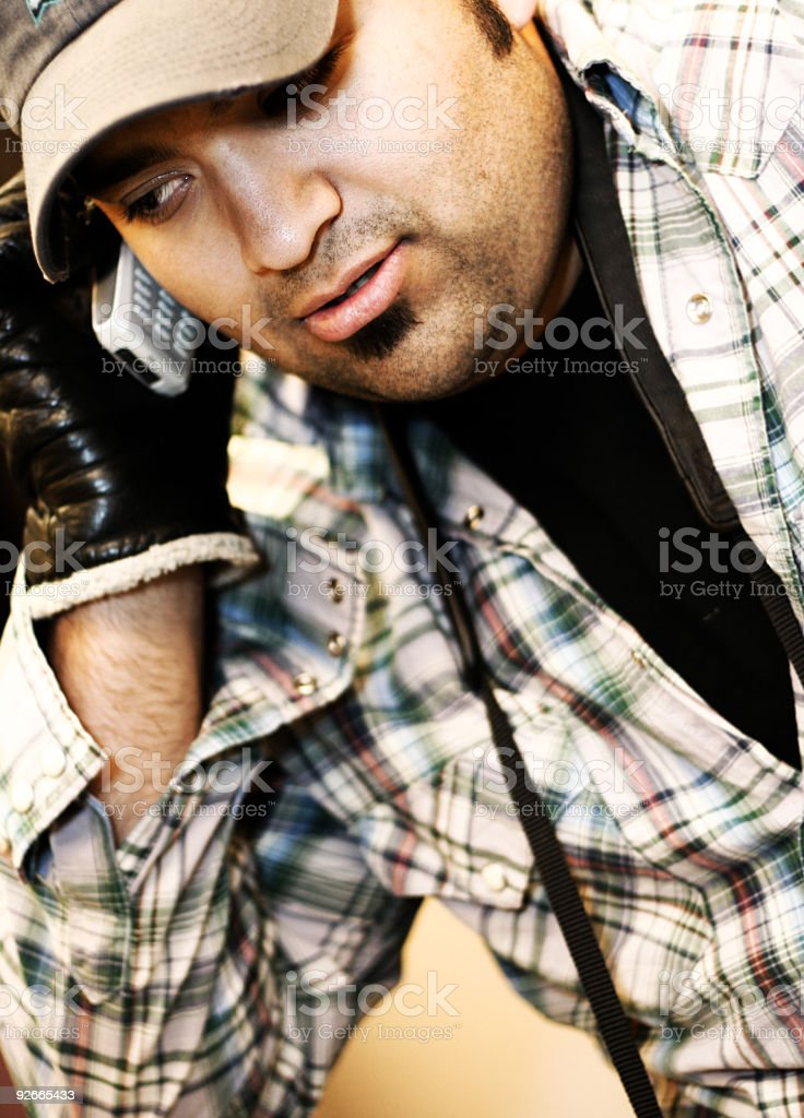 Hispanic Male on his Cell Phone royalty-free stock photo