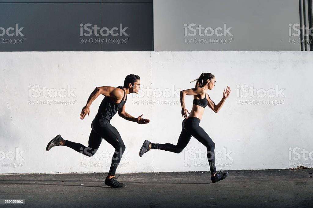 Hispanic Man and Women Running Together - foto stock