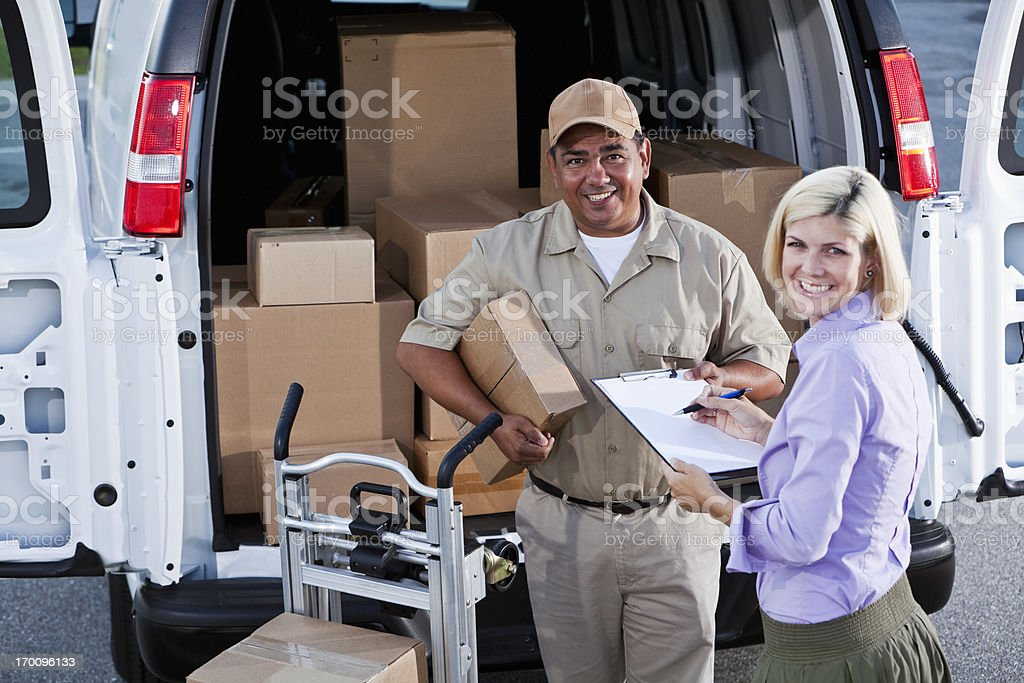 Hispanic man delivering packages stock photo