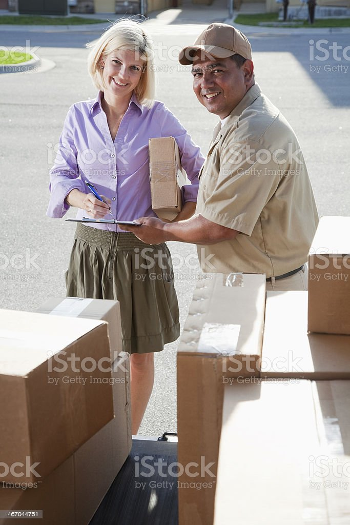 Hispanic man delivering packages to customer stock photo