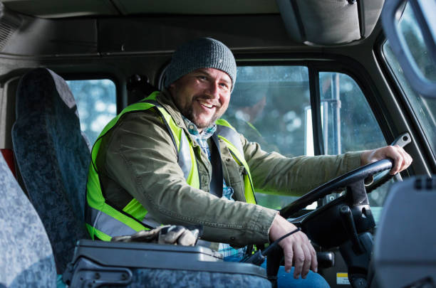 Hispanic man driving a truck stock photo