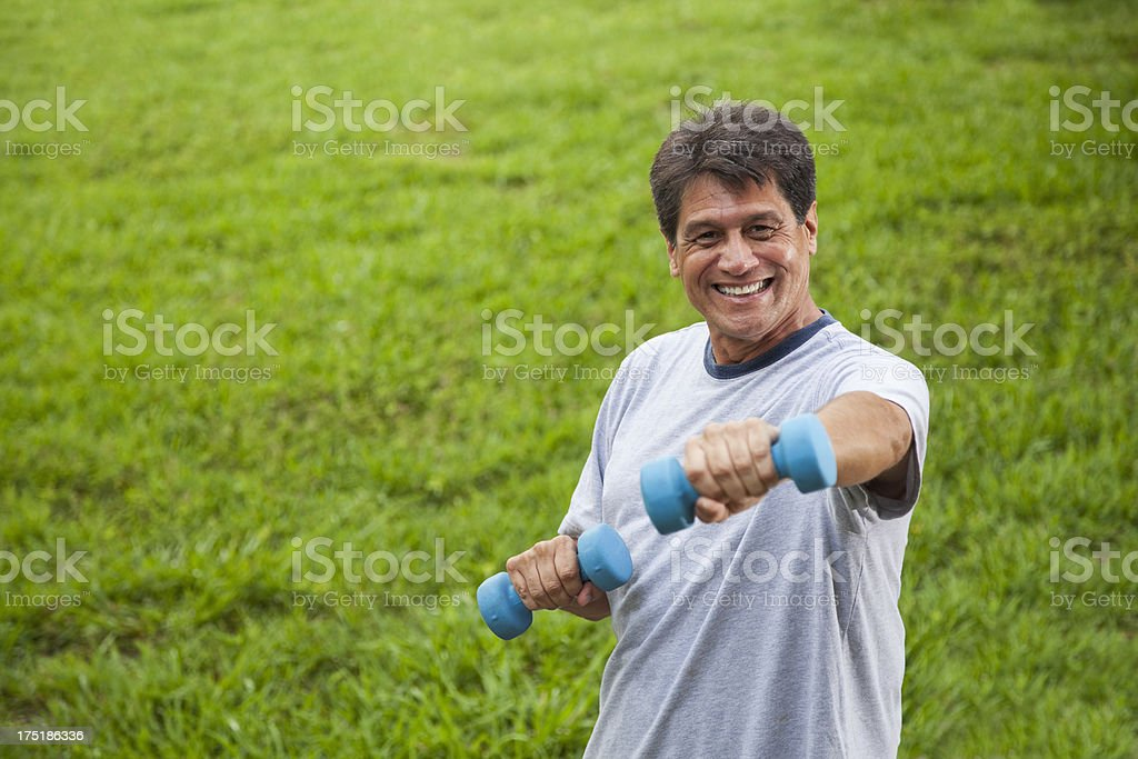 Hispanic man exercising outdoors stock photo