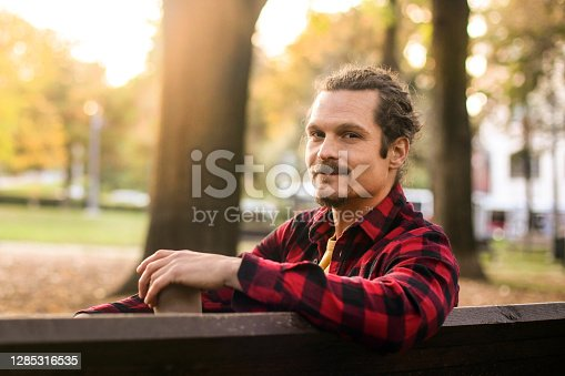 Mid adult man in a park. About 35 years old, Hispanic or Latin male.
