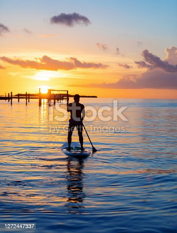Hispanic man in his late 40s paddle boarding in the Florida Keys