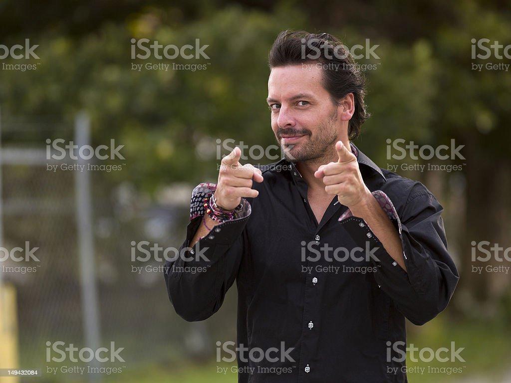 Hispanic Man pointing at the camera royalty-free stock photo