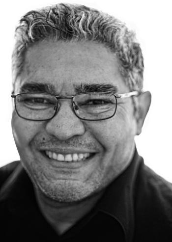 825083248 istock photo Hispanic Man smiling Selective Focus 523045518