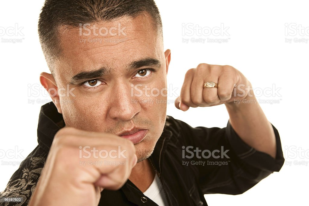 Hispanic Man Throwing Punch royalty-free stock photo