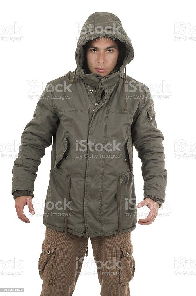 hispanic man wearing jacket and hoodie stock photo