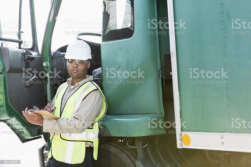 Hispanic man with truck royalty-free stock photo