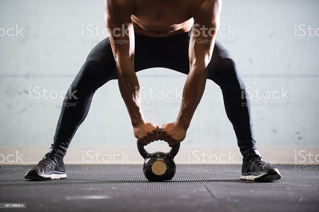 Hispanic Man Working Out With A Kettlebell stock photo
