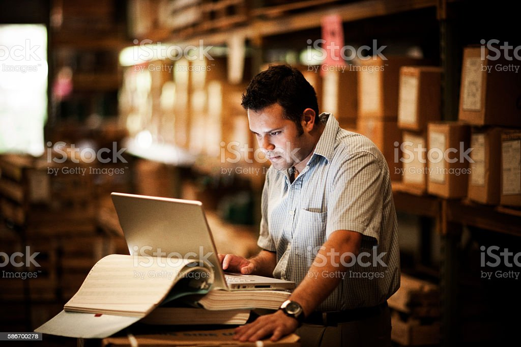 Hispanic Manager in Warehouse stock photo