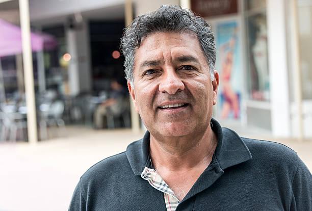 Hispanic mature man Mature Hispanic man smiling 55 59 years stock pictures, royalty-free photos & images