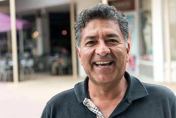 Hispanic mature man Mature Hispanic man laughing 55 59 years stock pictures, royalty-free photos & images