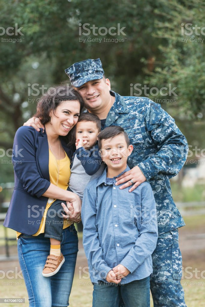 Hispanic military man with his family stock photo
