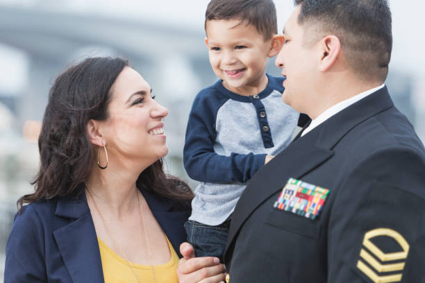 Hispanic military man with little boy and wife stock photo
