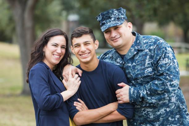 Hispanic military man with teenage son and wife stock photo