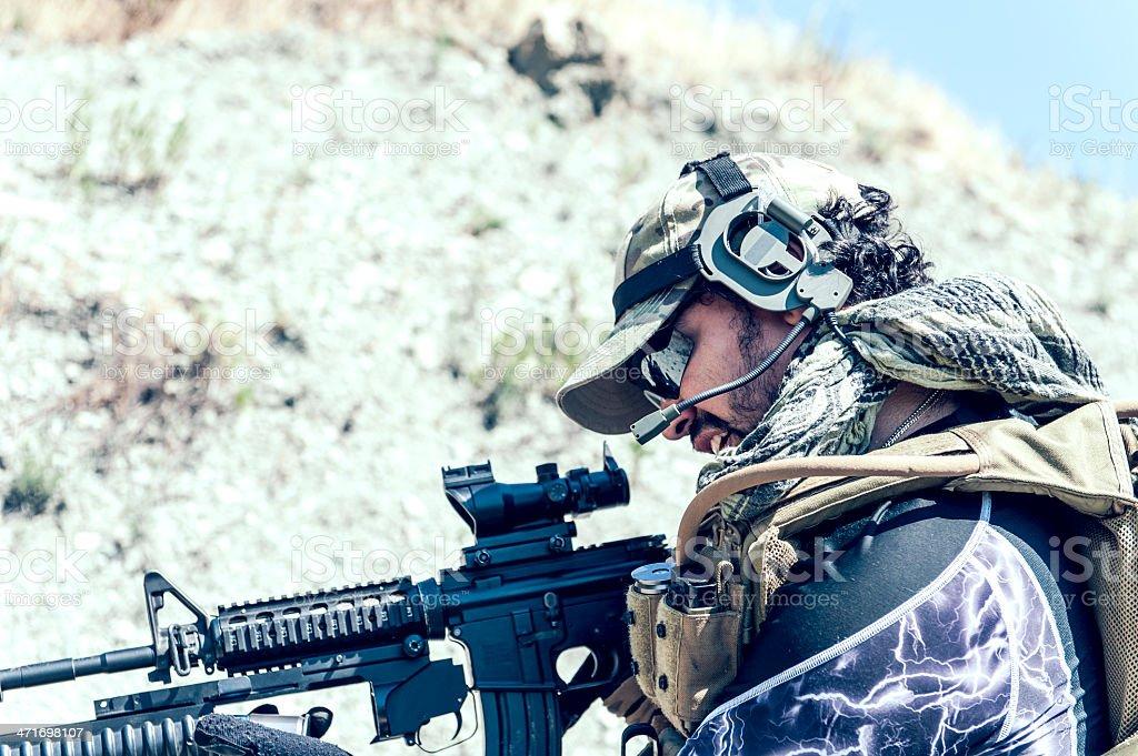 Hispanic Modern Army Soldier Loading Grenade on Assault Rifle royalty-free stock photo