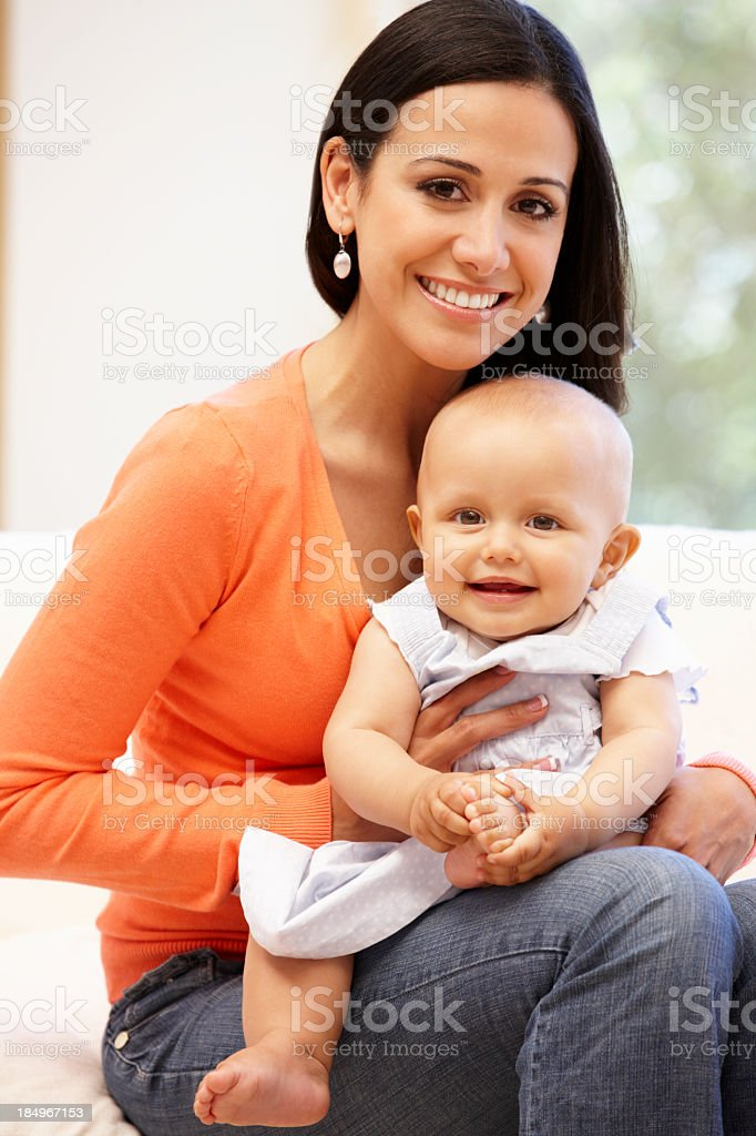 Hispanic mother and baby at home royalty-free stock photo