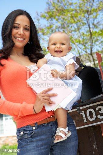 istock Hispanic Mother And Baby Checking Mailbox 184391907