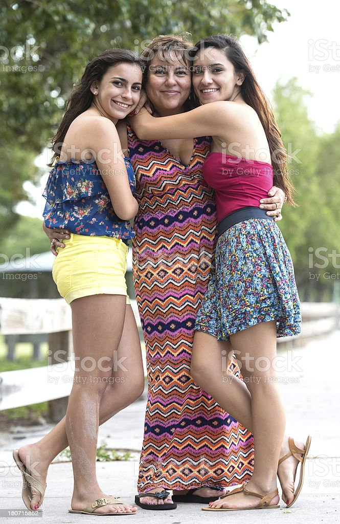 Hispanic mother and daughters stock photo