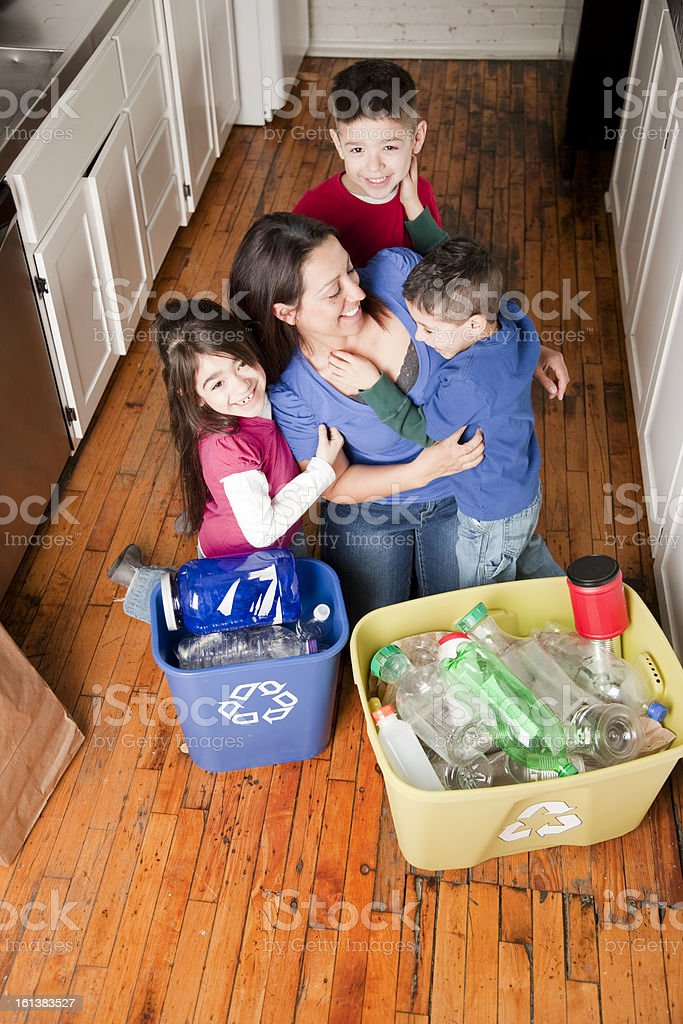 Hispanic mother and three kids recycle royalty-free stock photo