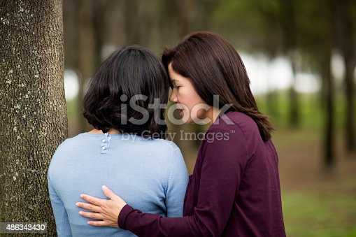 Latin American mature woman consoling her young daughter