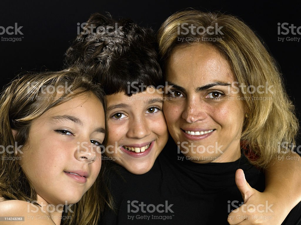 Hispanic mother with her two children royalty-free stock photo