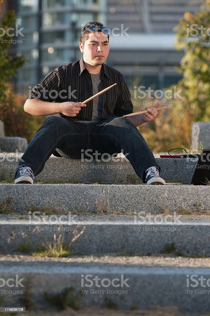 Hispanic  Musician with Drumsticks and Laptop royalty-free stock photo