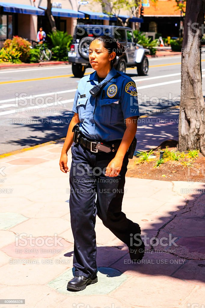 Hispanic Policewoman walking in downtown Santa Barbara stock photo